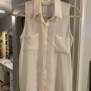 Sleeveless blouse cream colored